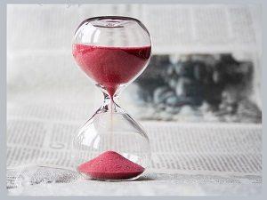 sand running through hourglass
