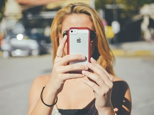 woman taking picture with iphone