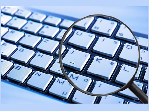 keyboard viewed through magnifying glass